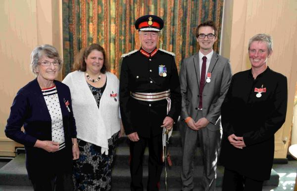 CEREMONY: Dorset's Lord-Lieutenant Angus Campbell presents medals to, from left, Vanetta Westell, Helen Warren, Adam Tuffrey and Gail McGarva