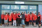 IN THE PICTURE: Bob Elliot presents the action camera to Portland Gig Rowing Club chairman Ron Peach and club members