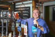 Paul Smith pulls the first pint at the opening for the Old Rooms Inn