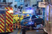 A man died after having a medical episode before his car hit a shop