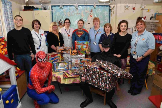 Superheroes swoop in to spread festive cheer