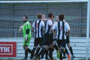 OPENER: Nathan Walker is congratulated after scoring the Magpies' first goal at Chesham Picture: TREVOR HYDE