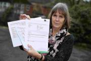 Sue Bray from the chalet group with the incorrect bill and the correct bill, which was sent out by the council for the rent of a chalet