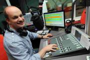 LISTEN UP: Air 107.2's station manager Carl Greenham celebrates the news
