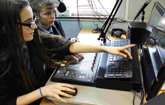 Carla Gilfillan (left) and Lucy Turnbull broadcast the news on Wey Valley Radio