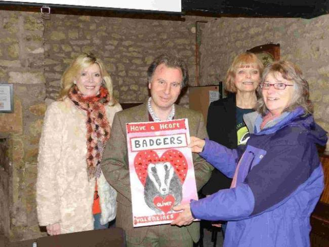 West Dorset MP Oliver Letwin is given a Valentine's message from the Dorset for Badger and Bovine Welfare group. From left, Kathy Livick, Karin Snellock and Tessa Harding