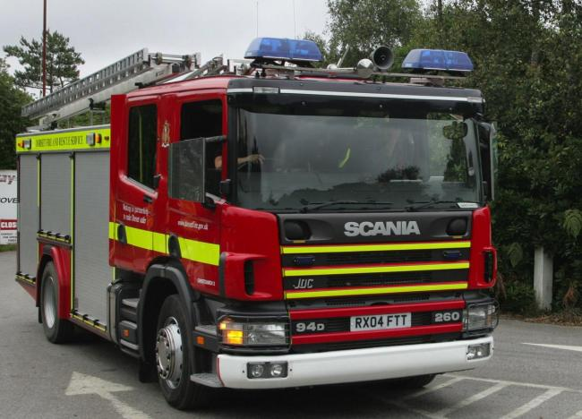 Firefighters tackle car blaze