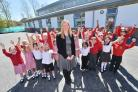 Manor Park First School pupils celebrate their Ofsted success with headteacher Melanie Cridland in front of the new classrooms - 210415, Picture GRAHAM HUNT HG13055 (23984923)