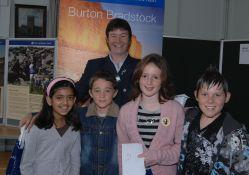 Burton Bradstock school beach project prize winners. Helen Mann National Trust Property Manager West Dorset presented the awards to l/r, Monisha Vij, James Noonan, Amy Van Zyl and Samuel Lamble,. Picture: Brian Jung\bj6273