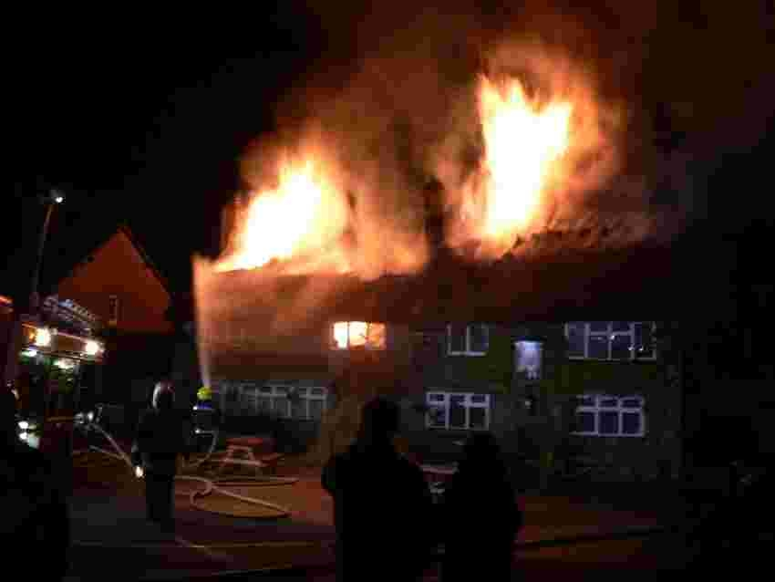 FIRE HORROR: Firemen tackle the blaze at The Wise Man at West Stafford