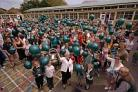 GOODBYE: Staff and pupils of the infants school led by the retiring head Lyn Darley release balloons