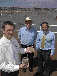 SEABED SURVEY: Marine engineer Ian Cruickshank, left, shows borehole and beach sand samples to consultant Richard Fenton, centre, and Howard Holdings regional director Gary Charman