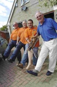 WE'RE TAKING STEPS: Mike Sutton, right, with workmen Phill Tattershall, Mike Messer and Alun Horniblow and one of a collection of false legs found in the cellar of Mike's house in Bridport