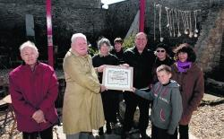 John Reeby, left, from Weymouth Civic Society presents an award to members of the Chiswell Walled Garden