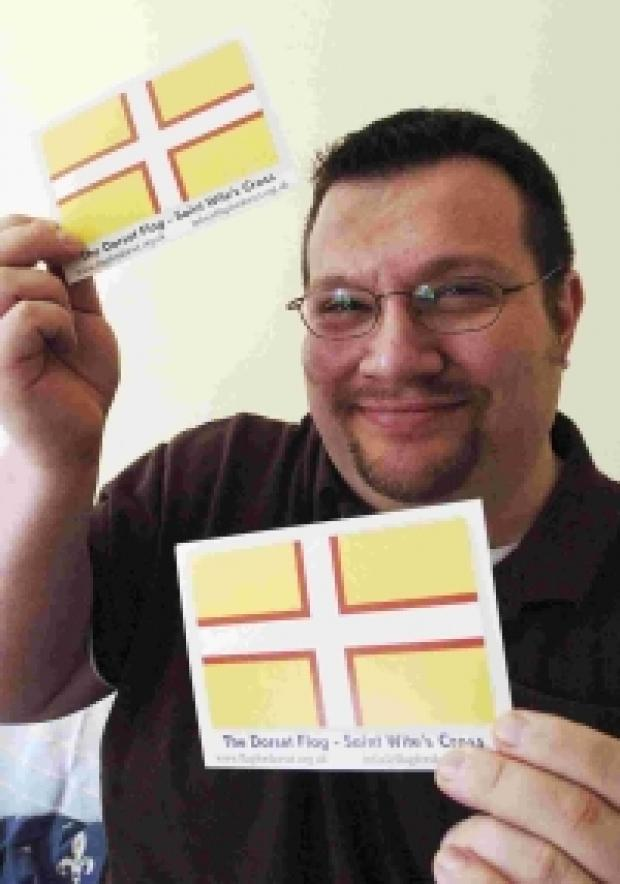 FLYING THE FLAG: Dave White with his idea for a Dorset flag