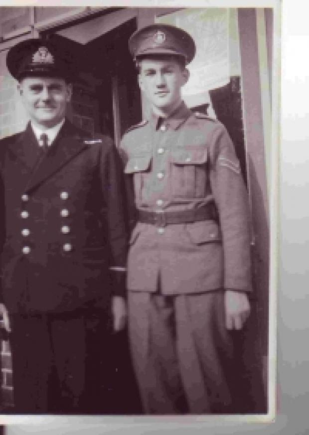 Peter and his father, Frank Love, a commissioned engineer in the Royal Navy, stand outside 246, Chickerell Road, in their uniforms (Peter was in the Army Cadet Force). Peter is 15 or 16