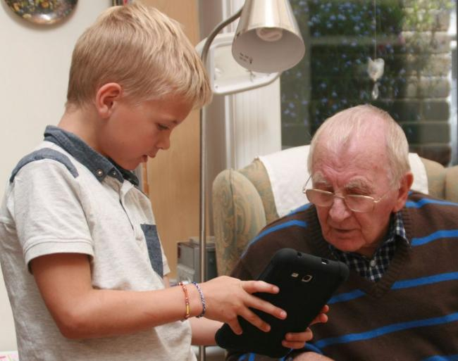 UP TO SPEED: Grassington House resident Frankie Simpkin gets to grips with the home's new equipment thanks to help from local nursery children