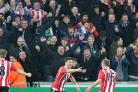 Southampton's Shane Long (second right) celebrates scoring his side's winner in their 1-0 victory at Swansea.