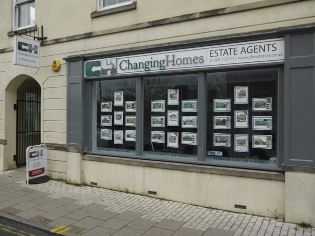 Dorset Echo: Changing Homes Estate Agents Window Front
