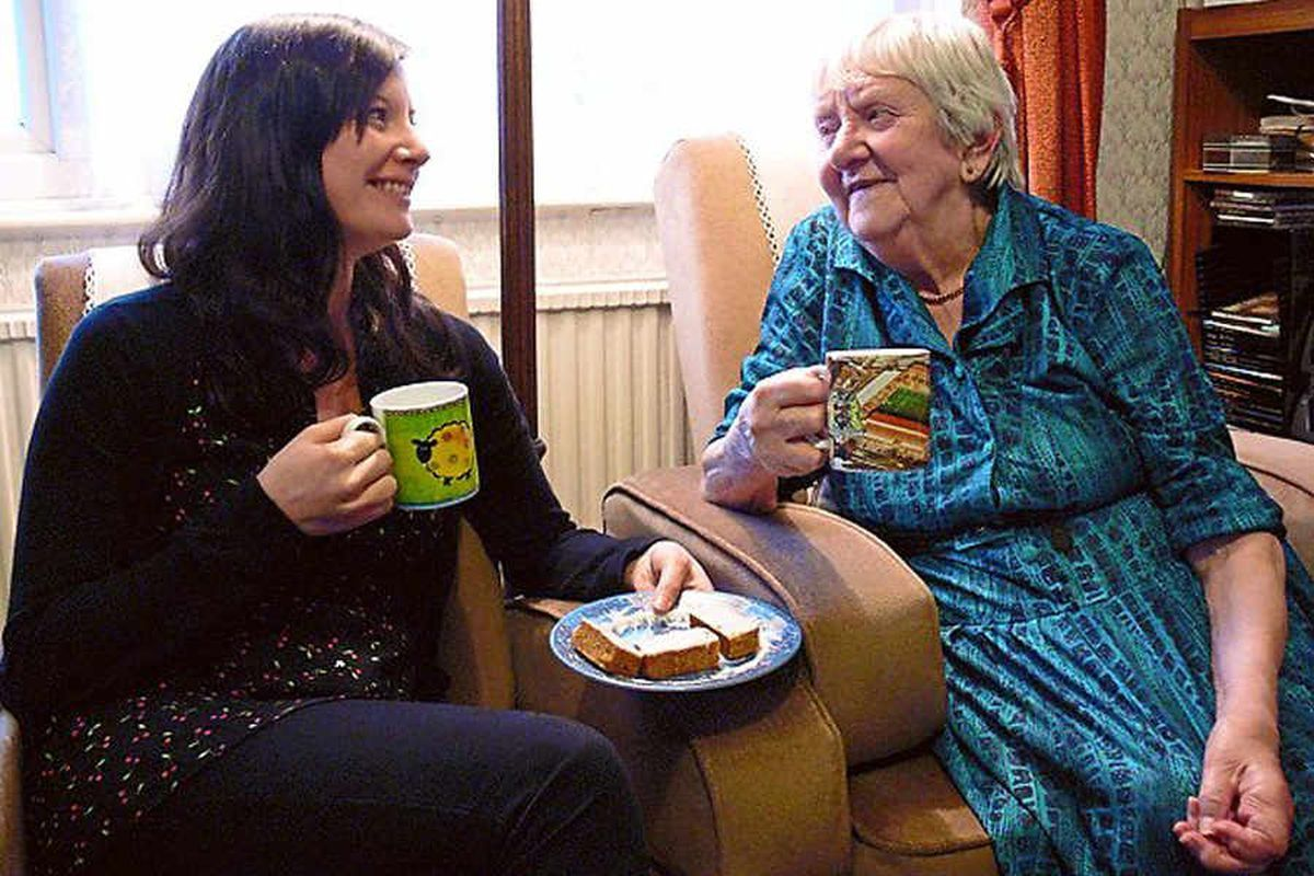REACHING OUT: An Age UK volunteer offering support