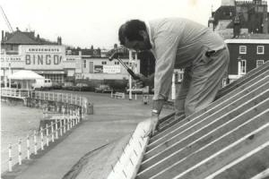 LOOKING BACK: George Pering from Portland working on the roof of the seafront shelters