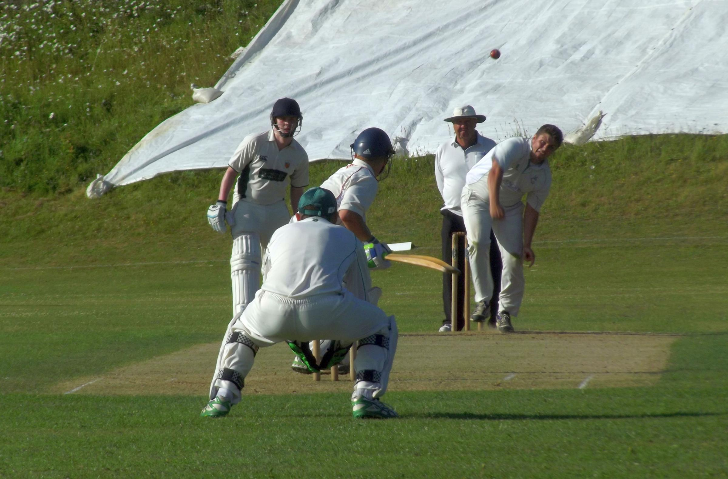 WICKET HUNT: Sam Kershaw bowling for the home side at the Dorchester middle order.