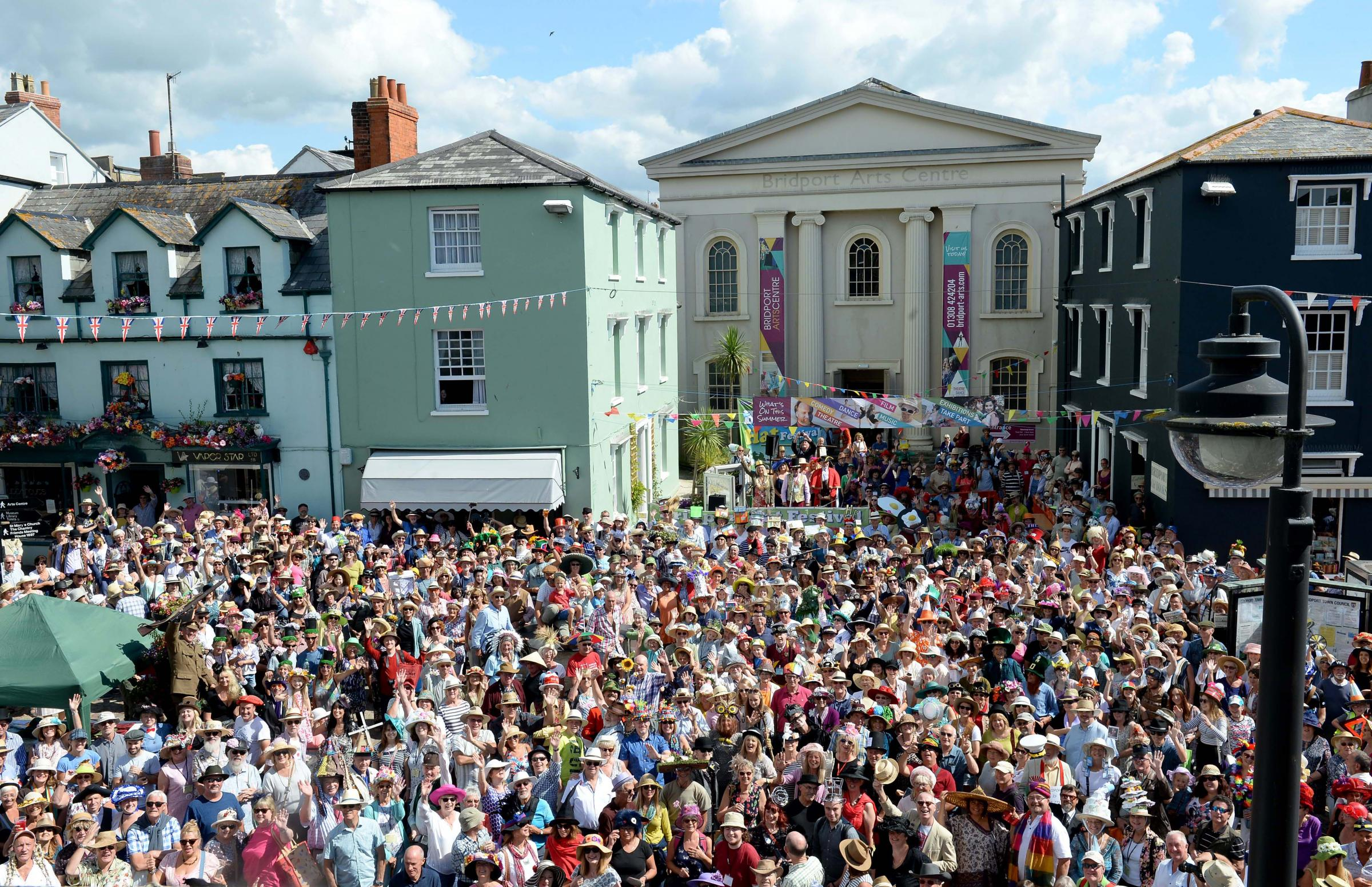 HATS OFF: One of Bridport's charms is the eccentric annual Hat Festival   Picture: FIinnbarr Webster