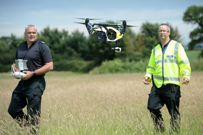 Officers fly a DJI Inspire 1s drone