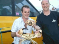 CLAWS: Paul Martin, left, holding the male crab with fellow diver Nigel Holder, holding the female crab
