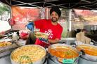 CURRYING FAVOUR: Tony Taak, The Curry Man at Pommery Dorset Seafood Festival. Picture: SAMANTHA COOK