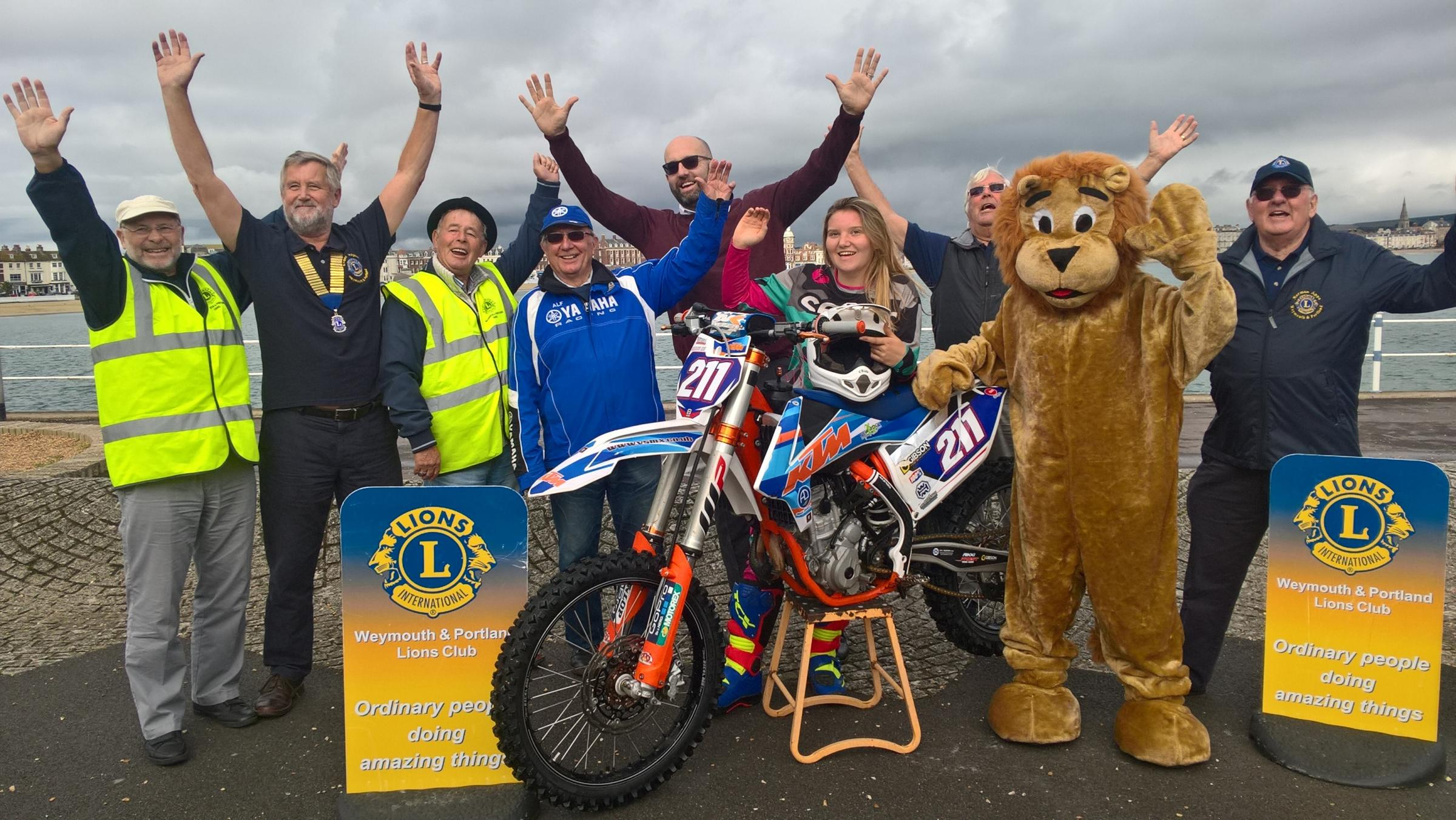 Representatives and organisers from the W&P Lions Club and Purbeck Motocross Club with British motocross rider Charlotte Hall