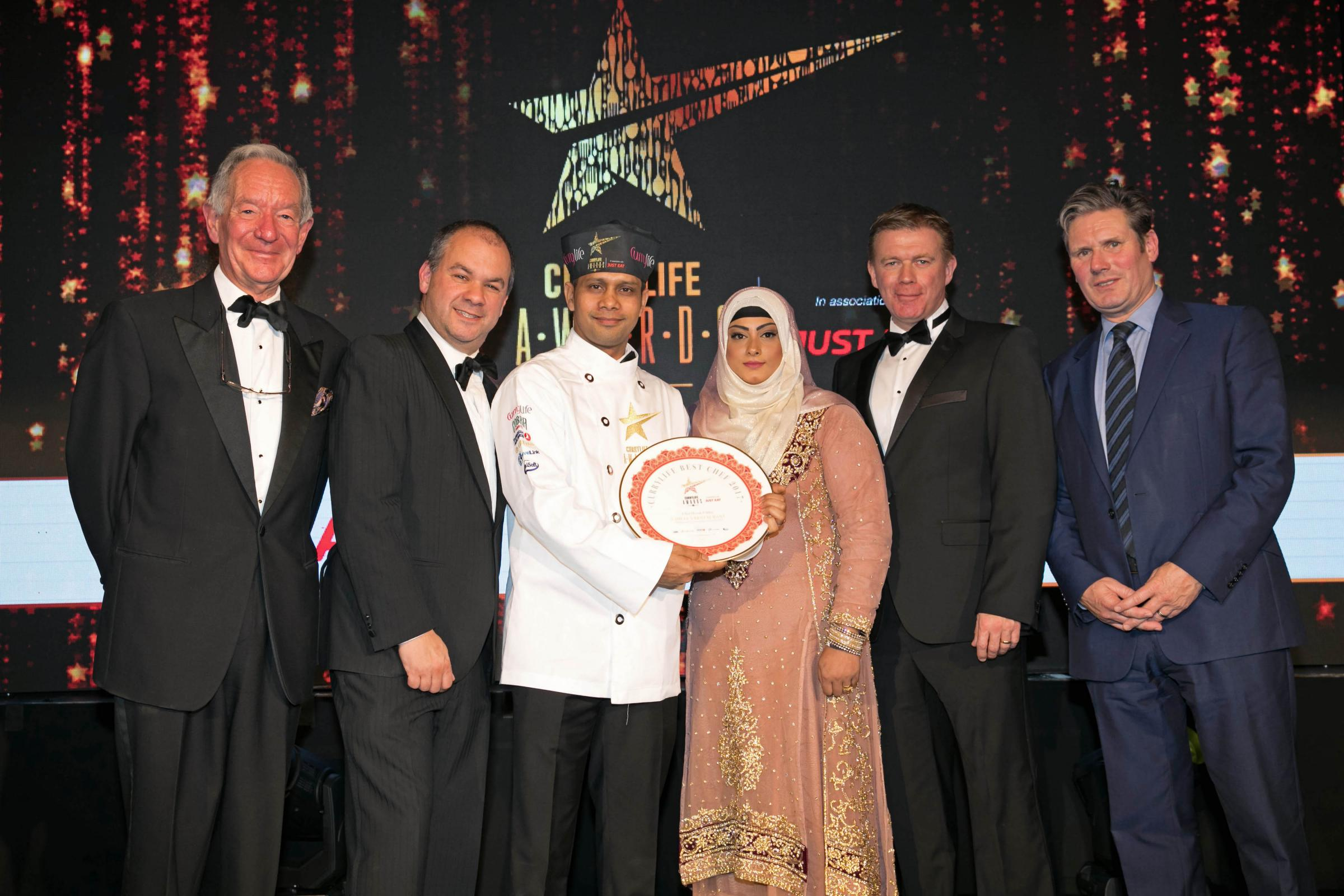 Curry Life Awards 2017, Lancaster Hotel - 22Oct17. (l-r) Michael Buerk, Journalist and Broadcaster, Mr Paul Scully MP, Wining Chef Herok Uddin and Manager Panna Uddin from Chilli's Restaurant, Mr Graham Corfield, UK Managing Director of Just Eat and Sir