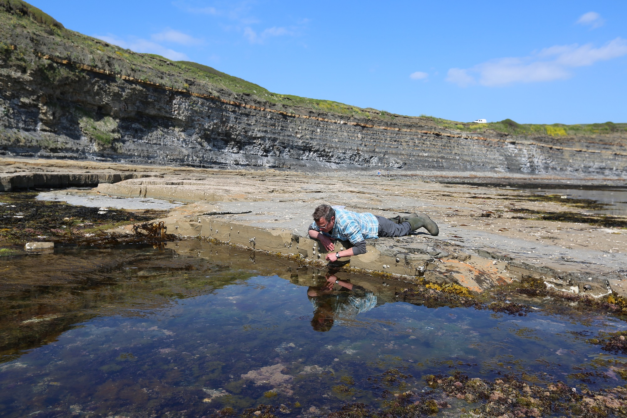 INQUISITIVE: Hugh Fearnley-Whittingstall looking into a rock pool as part of his Hugh's Wild West TV series