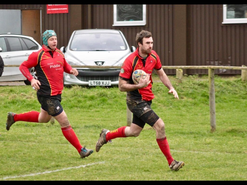 CROSSING THE LINE: Puddletown's James House goesin for his first try Picture: CHRIS EDWARDS