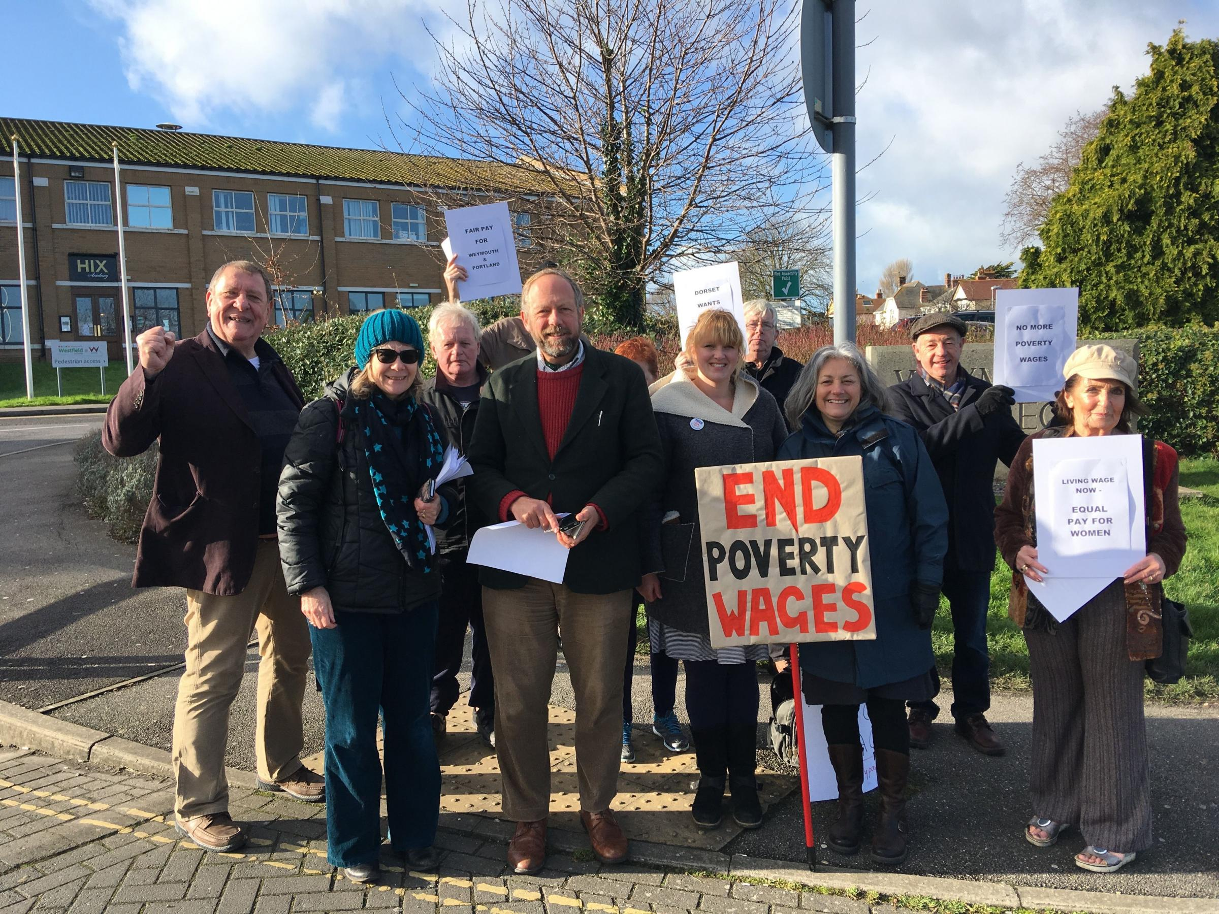 END POVERTY WAGES: Campaigners outside Weymouth College