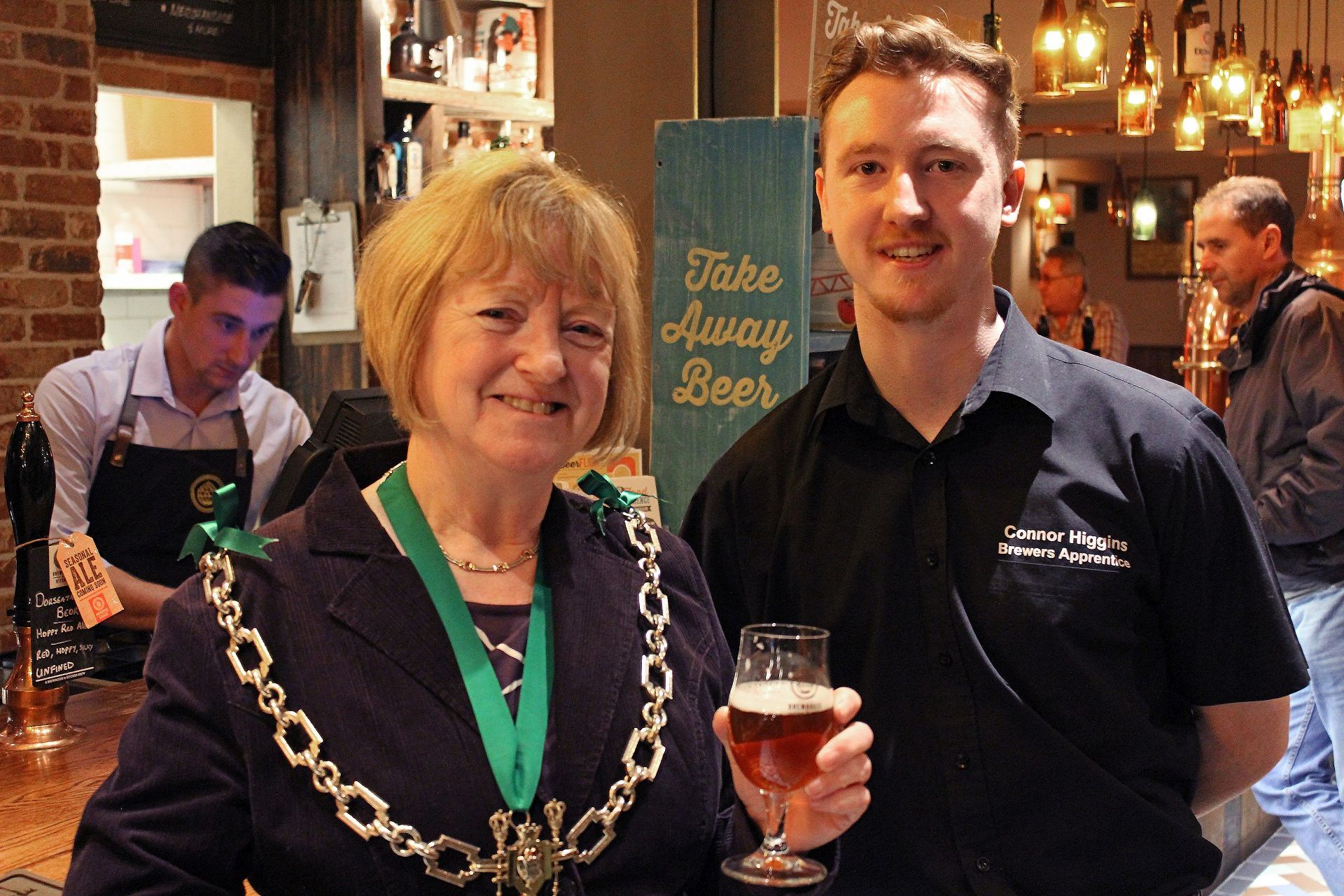 CHEERS: Mayor of Dorchester, Cllr Susie Hosford with Connor Huges, brewers apprentice