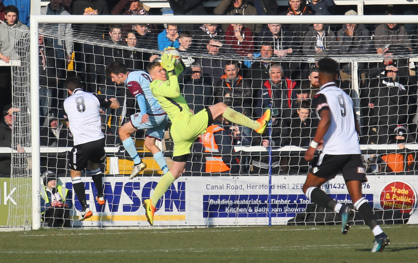 WELL CLAIMED: Weymouth goalkeeper Will Dennis gathers with Ashley Wells, second left, covering       Picture: MARK PROBIN