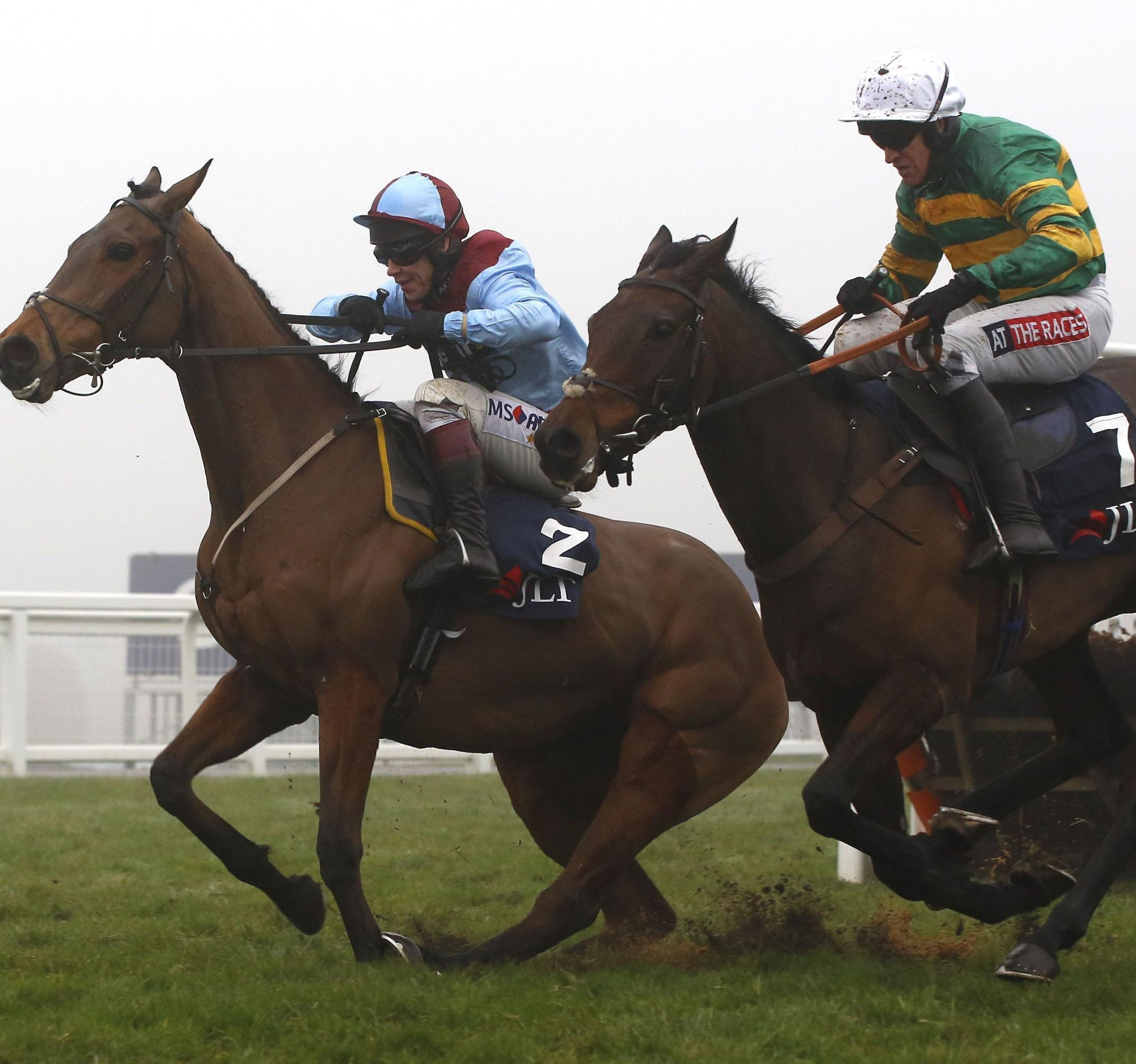 DARK HORSE: Harry Fry's Unowhatimeanharry, right                        Picture: JULIAN HERBERT/PA WIRE
