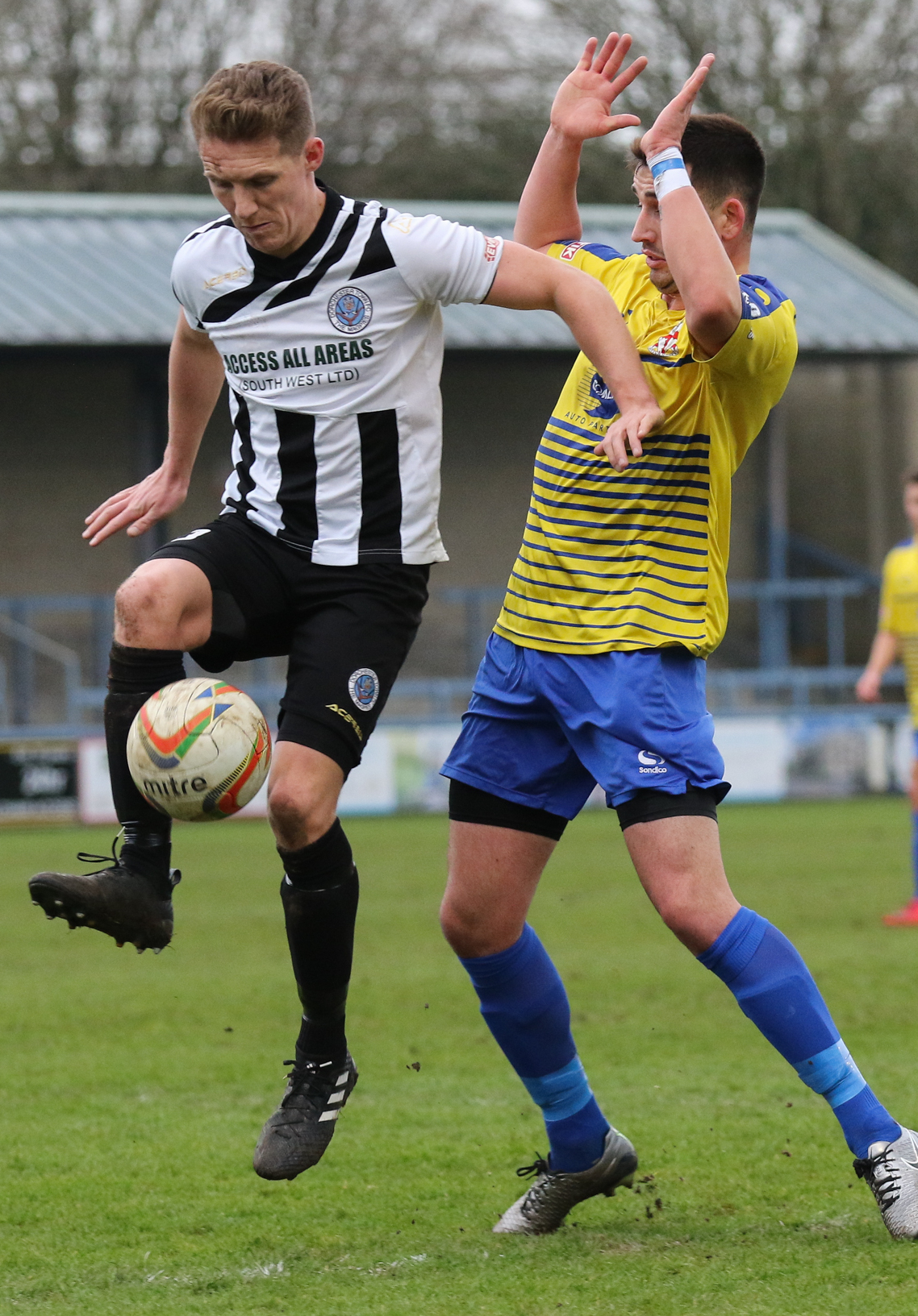 MATTER OF PRIDE: Dorchester Town midfielder Sam Lanahan, left         Picture: PHIL STANDFIELD
