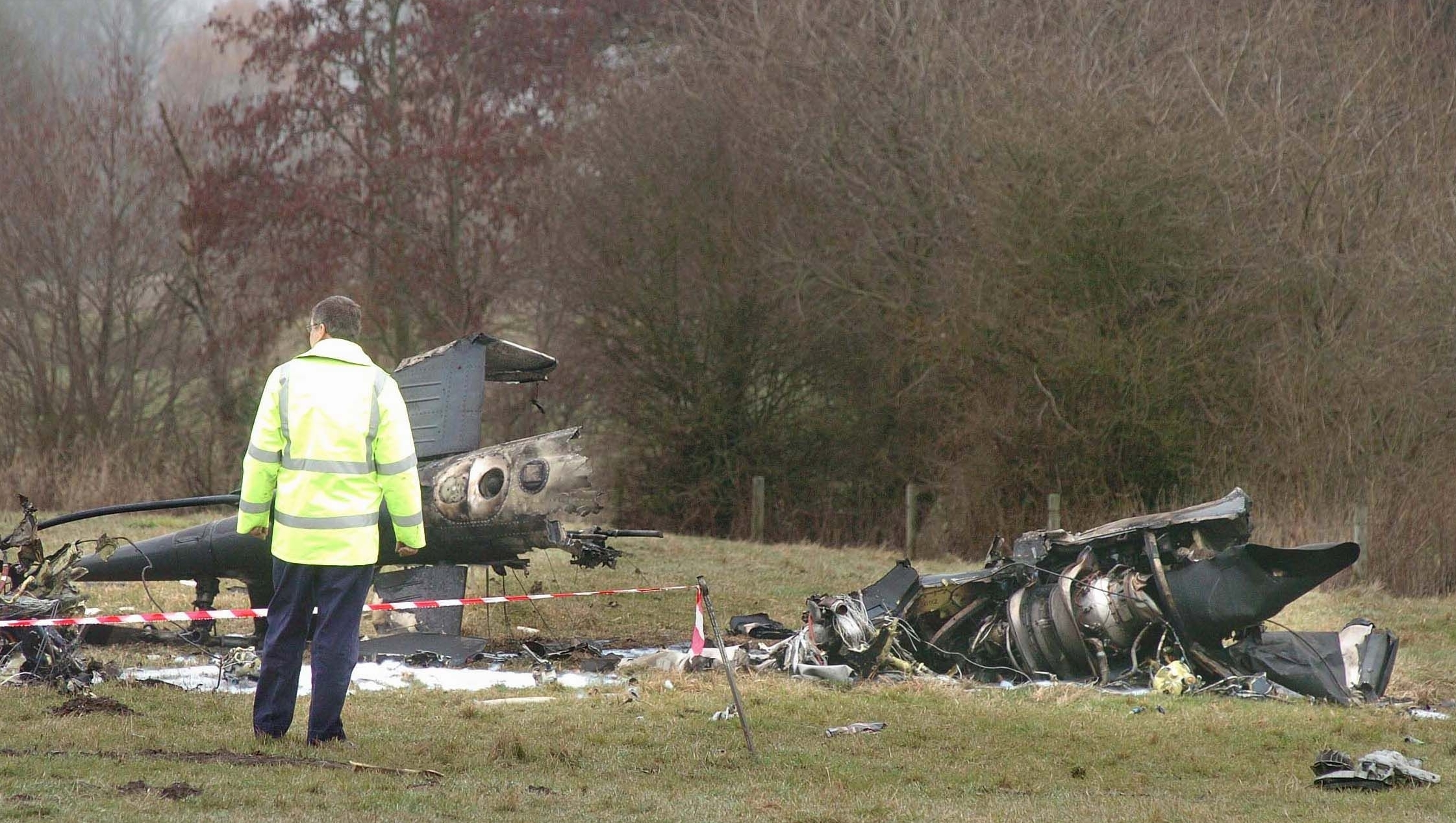 Investigators study the wreckage of the Agusta 109 helicopter which plunged into fields close to Bournemouth Airport - killing lawyer Stephen Curtis