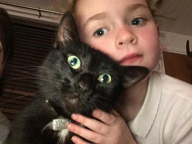 My daughter Amelia with her pet cat Nala