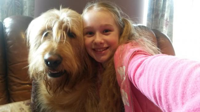 Kelsey Farwell with her dog Buddy