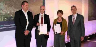 HONOUR: Patrick Charlton and Rosalyn Guard of Environs Partnership receive awards from Nick Crane, right