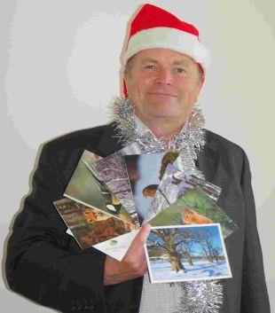 RECYCLING; Clive Anderson is urging Dorset residents to recycle their Christmas cards with the Woodland Trust