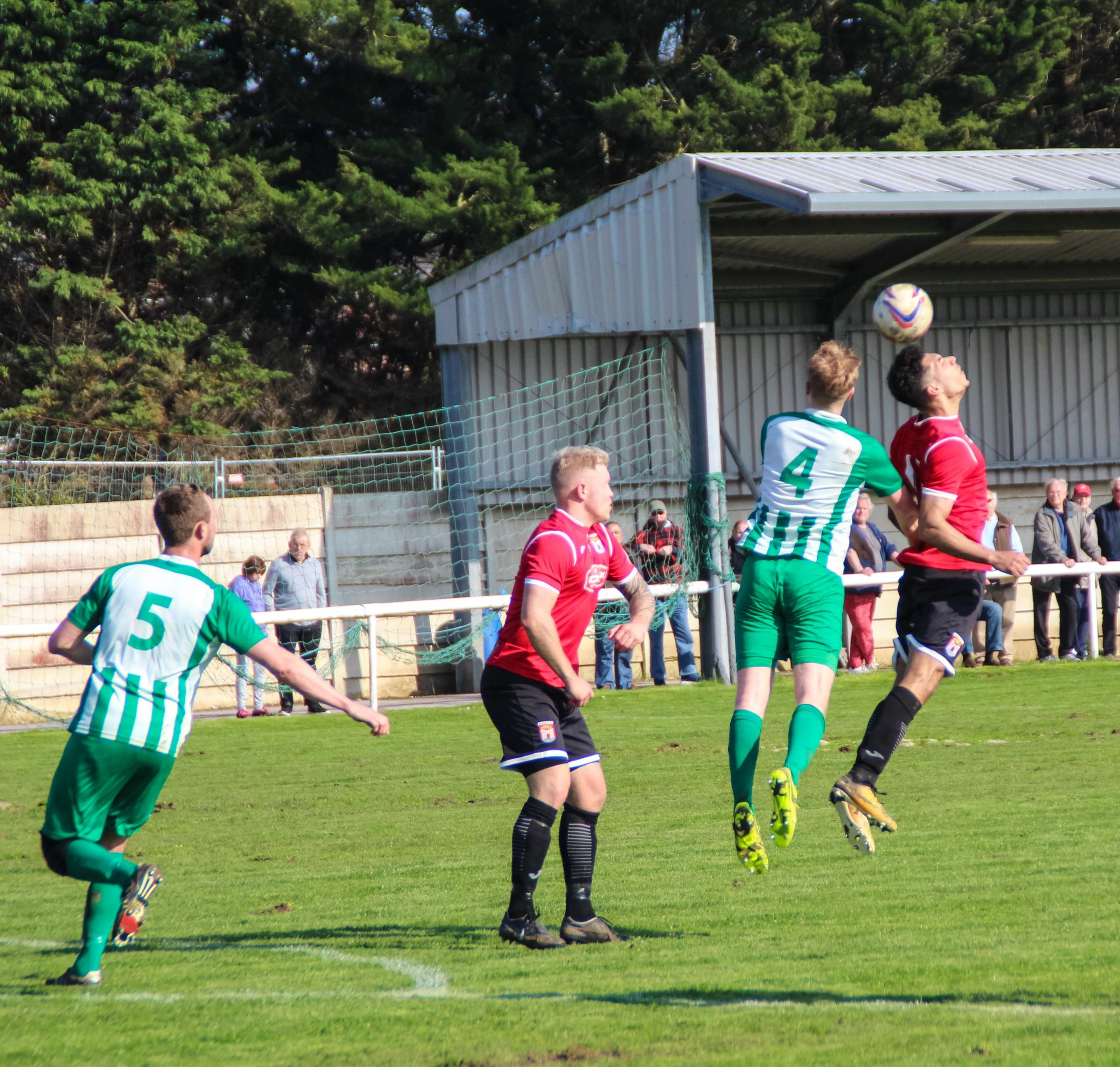 LEVELLER: Leigh Bailey, centre, scored a 56th-minute equaliser for Bridport Picture: LOIS BUTCHER