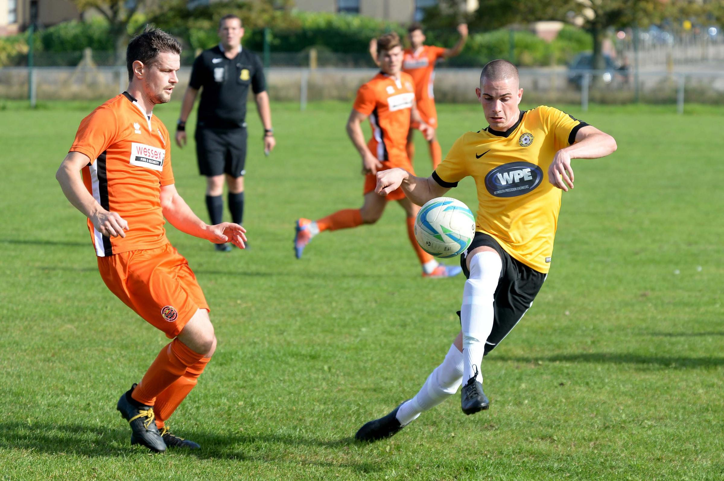 IN CONTENTION: Balti midfielder Ethan Devaney, right, could return 	   Picture: FINNBARR WEBSTER/F19224