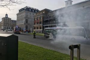 Dramatic pictures show firefighters tackle bus fire