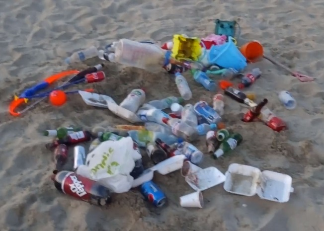 A still picture from Mr Taylor's video, showing items discarded on Wemyotuh Beach