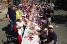 Neighbours gather to eat, drink and celebrate the Royal Wedding at a street party on Roman Road, Weymouth