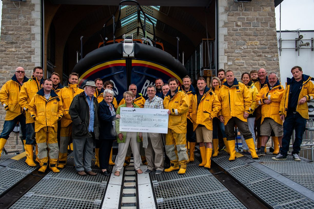 The cheque is presented to Swanage Lifeboat Station. CREDIT: Roydon Woodford